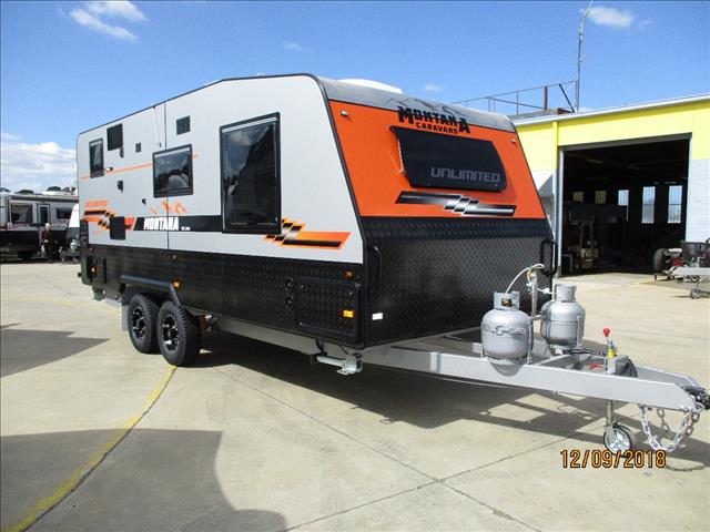"2018 Montana Unlimited 19'6"" Tandem Off Roader, Queen Bed, Cafe Seating, Ensuite......."